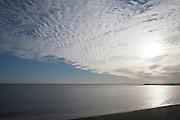 A mackerel sky or buttermilk sky of altocumulus clouds over Shingle Street, Suffolk, England