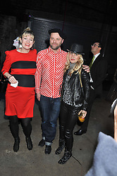 Left to right, ROSIE ALLERHAND, GAVIN TURK and VIRGINIA DAMTSA at the Contemporary Art Society's Gala evening held at the Farmiloe Buildings, St.John Street, London EC1 on 29th February 2012.