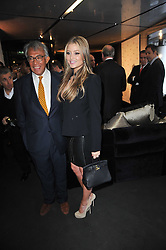 HOLLY VALANCE and SIR DAVID TANG at the launch of One Hyde Park, The Residences at Mandarin Oriental, Knightsbridge, London on 19th January 2011.