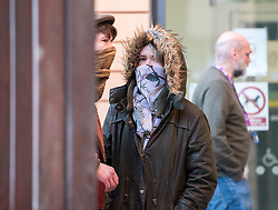 © Licensed to London News Pictures; 25/01/2021; Bristol, UK. Colston Four at court. RHIAN GRAHAM (in hood) arrives at Bristol magistrates court. Defendants Rhian Graham, 29, Milo Ponsford, 25, Jake Skuse, 32, and Sage Willoughby, 21, are due before Bristol Magistrates' Court for their first hearing today. They have been charged with criminal damage in connection with damage to the statue of slave trader Edward Colston which was pulled down during a Black Lives Matter protest on June 7 2020 and then thrown into Bristol Harbour. Police launched an appeal to trace suspects after the event and ten people were located. Six people accepted a caution while four were referred to the CPS. The statue was later retrieved by Bristol City Council who say that the damage is costed at £3,750. Police have warned anyone planning to protest at the court hearing that they will be breaking the lockdown laws which prohibit public gatherings of more than two people to combat the Covid-19 coronavirus pandemic. Photo credit: Simon Chapman/LNP.