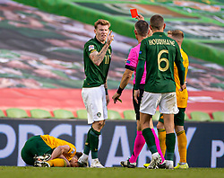 DUBLIN, REPUBLIC OF IRELAND - Sunday, October 11, 2020: Republic of Ireland's James McClean points as referee Tasos Sidiropoulos shows him the red card and sends him off during the UEFA Nations League Group Stage League B Group 4 match between Republic of Ireland and Wales at the Aviva Stadium. The game ended in a 0-0 draw. (Pic by David Rawcliffe/Propaganda)