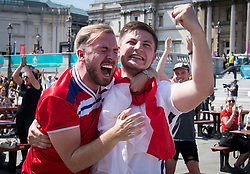 © Licensed to London News Pictures. 13/06/2021. London, UK. Fans celebrate England going 1-0 up. England fans gather in the Fan Zone at Trafalgar Square in central London for England's opening game of the 2020 European Championship against Croatia. Photo credit: Ben Cawthra/LNP