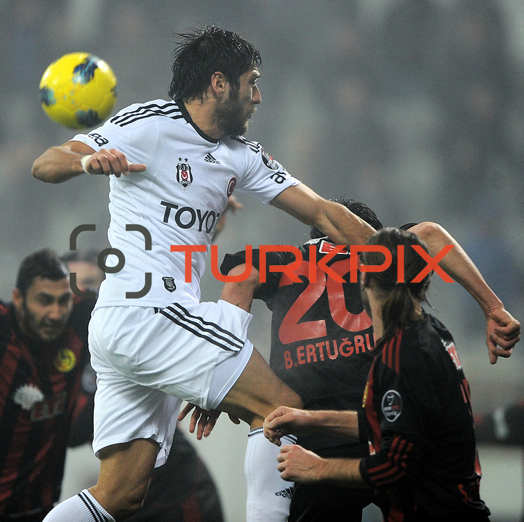 Besiktas's Egemen Korkmaz (L) during their Turkish superleague soccer match Besiktas between Eskisehirspor at BJK Inonu Stadium in Istanbul Turkey on Wednesday, 04 January 2012. Photo by TURKPIX