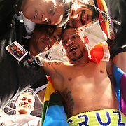 KISSIMMEE, FL - JULY 15: Orlando Cruz celebrates with members of the Kissimmee LGBT club after his victory over Alejandro Valdez during a boxing match at the Kissimmee Civic Center on July 15, 2016 in Kissimmee, Florida. Cruz was the first professional boxer to announce himself as gay and recently lost four friends in the Pulse Nightclub shooting in Orlando, he dedicated this match to his lost friends and won the bout by TKO in the 7th round.  (Photo by Alex Menendez/Getty Images) *** Local Caption *** Orlando Cruz; Alejandro Valdez