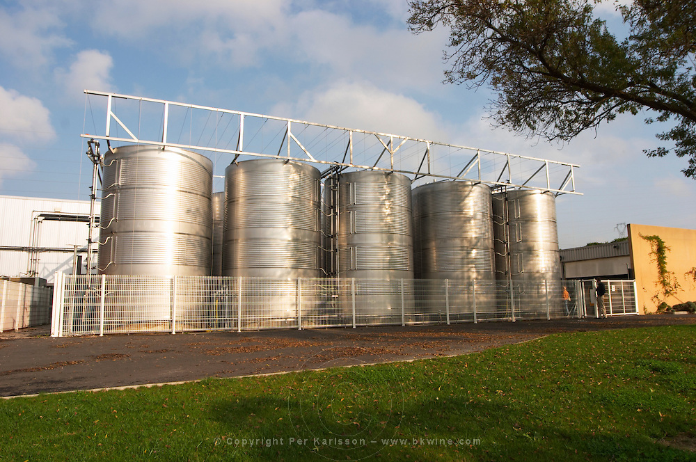 Mas La Chevaliere. near Beziers. Languedoc. The winery building. Outside tanks. Stainless steel fermentation and storage tanks. France. Europe.