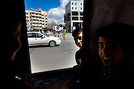 Children direct traffic at an intersection in Benghazi on March 1, 2011.
