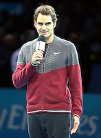 Roger Federer (SUI) explains why he will not be able to play against Novak Djokovic (SRB) in their Singles Final match<br /> due to injury<br /> <br /> Photographer Kieran Galvin/CameraSport<br /> <br /> International Tennis - Barclays ATP World Tour Finals - O2 Arena - London - Day 8 - Sunday 16th November 2014<br /> <br /> © CameraSport - 43 Linden Ave. Countesthorpe. Leicester. England. LE8 5PG - Tel: +44 (0) 116 277 4147 - admin@camerasport.com - www.camerasport.com