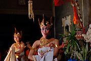 Young women dancing traditional Balinese dance, the Tari Belibis. Sanur, Bali, Indonesia