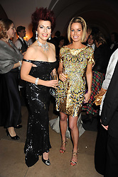 Left to right, CLEO ROCCOS and CAROLINE HABIB at Chaos Point - a fashion show from Viienne Westwood's Gold Label Collection in aid of the NSPCC at The Banqueting House, London SW1 on 18th November 2008.