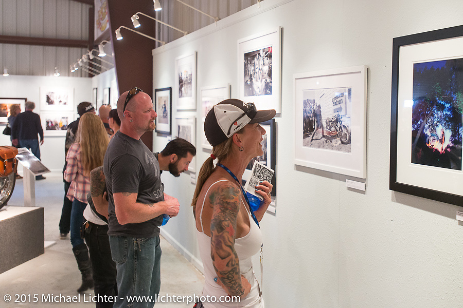 Checking out Michael Lichter's exhibition of photography in the Naked Truth exhibition at the Buffalo Chip gallery during the 75th Annual Sturgis Black Hills Motorcycle Rally.  SD, USA.  August 5, 2015.  Photography ©2015 Michael Lichter.