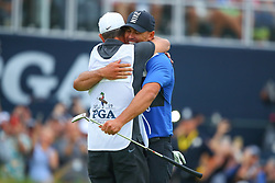May 19, 2019 - Farmingdale, NY, U.S. - FARMINGDALE, NY - MAY 19:   Brooks Koepka of the United States hugs his caddy Rickie Elliott after winning the 2019 PGA Championship at the Bethpage Black course with a score of 8 under par on May 19, 2019 in Farmingdale, New York.(Photo by Rich Graessle/Icon Sportswire) (Credit Image: © Rich Graessle/Icon SMI via ZUMA Press)