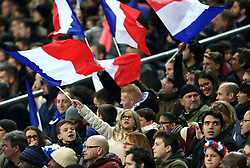 A young France supporter waves a flag in the stands during the International Friendly match at the Stade de France, Paris.