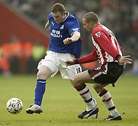 Photo. Aidan Ellis.<br /> Southampton v Everton.<br /> FA Barclaycard Premiership.<br /> 21/02/2004.<br /> Southampton's Danny Higginbotham and Everton's Wayne Rooney
