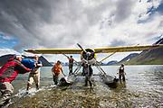 Unloading the Beaver on Kisaralik Lake at start of 100 mile raft trip down Kisaralik River, Alaska
