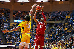 Feb 2, 2019; Morgantown, WV, USA; Oklahoma Sooners guard Christian James (0) shoots during the first half against the West Virginia Mountaineers at WVU Coliseum. Mandatory Credit: Ben Queen-USA TODAY Sports