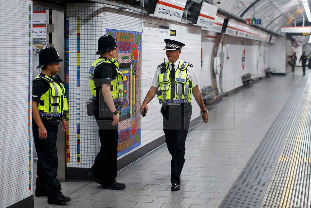 © Licensed to London News Pictures. 20/08/2016. London, UK. British Transport Police officer patrols at Tottenham Court Road station during the night tube service for the first time on 20 August 2016. Transport for London started a 24-hour Tube service on Victoria and Central lines as demand has soared over recent years, with passenger numbers on Friday and Saturday nights up by around 70 per cent since 2000. The plan was announced in November 2013 and intended to begin in September 2015, but strikes over pay delayed the start by nearly another year. Photo credit: Tolga Akmen/LNP