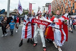 © Licensed to London News Pictures. 07/07/2021. LONDON, UK.  England fans in costume arrive outside Wembley Stadium ahead of the Euro 2020 semi-final between England and Denmark.  60,000 supporters, the most to watch a game since the pandemic began, will be in the stands as the UK government eased restrictions.  Photo credit: Stephen Chung/LNP
