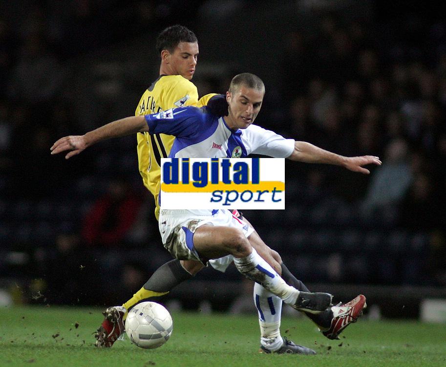 Photo: Paul Thomas.<br /> Blackburn Rovers v Arsenal. The FA Cup. 28/02/2007.<br /> <br /> David Bentley (White) of Blackburn tries to evade Jeremie Aliadiere.