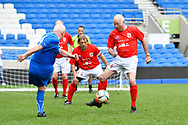Tommy Charlton of England over 60's blocks a shot from Vito Gibin (Captain) of Italy during the world's first Walking Football International match between England and Italy at the American Express Community Stadium, Brighton and Hove, England on 13 May 2018. Picture by Graham Hunt.
