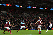 Christian Eriksen of Tottenham Hotspur (R) takes a shot at goal. Premier league match, Tottenham Hotspur v West Ham United at Wembley Stadium in London on Thursday  4th January 2018.<br /> pic by Steffan Bowen, Andrew Orchard sports photography.