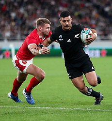 New Zealand's Richie Mo'unga (right) on his way to scoring his sides sixth try during the 2019 Rugby World Cup bronze final match at Tokyo Stadium.