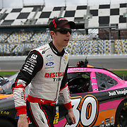 Driver Brad Keselowski leaves the track after the qualifying practice session of the NASCAR Nationwide Drive4COPD 300 was cancelled, at Daytona International Speedway on Friday, February 21, 2014 in Daytona Beach, Florida.  (AP Photo/Alex Menendez)
