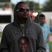 A young man wears a Trayvon Martin hoodie prior to the trial of George Zimmerman at the Seminole County Courthouse, Saturday, July 13, 2013, in Sanford, Fla. Zimmerman had been charged for the 2012 shooting death of Trayvon Martin, and was found not guilty. (AP Photo/Alex Menendez)