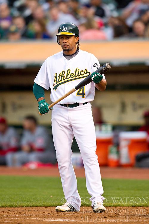 June 22, 2010; Oakland, CA, USA;  Oakland Athletics center fielder Coco Crisp (4) at bat against the Cincinnati Reds during the third inning at Oakland-Alameda County Coliseum.