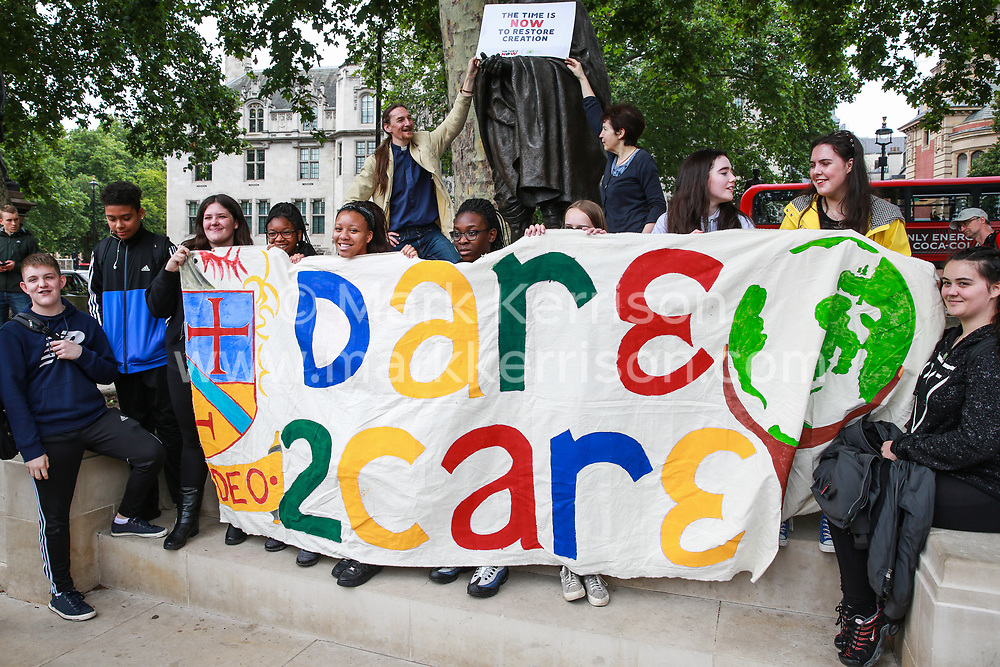London, UK. 26 June, 2019. Climate change activists from Dare2Care attend a mass lobby of Parliament for the climate and environment.