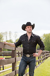 All American cowboy outdoors on a ranch
