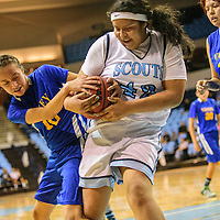 011915  Adron Gardner/Independent<br /> <br /> Valley Sanders Pirate Latisha Nastcio (10), left, and Window Rock Scout Marissa Charley (42) fight for possesion at the Stronghold Event Center in Fort Defiance Monday.