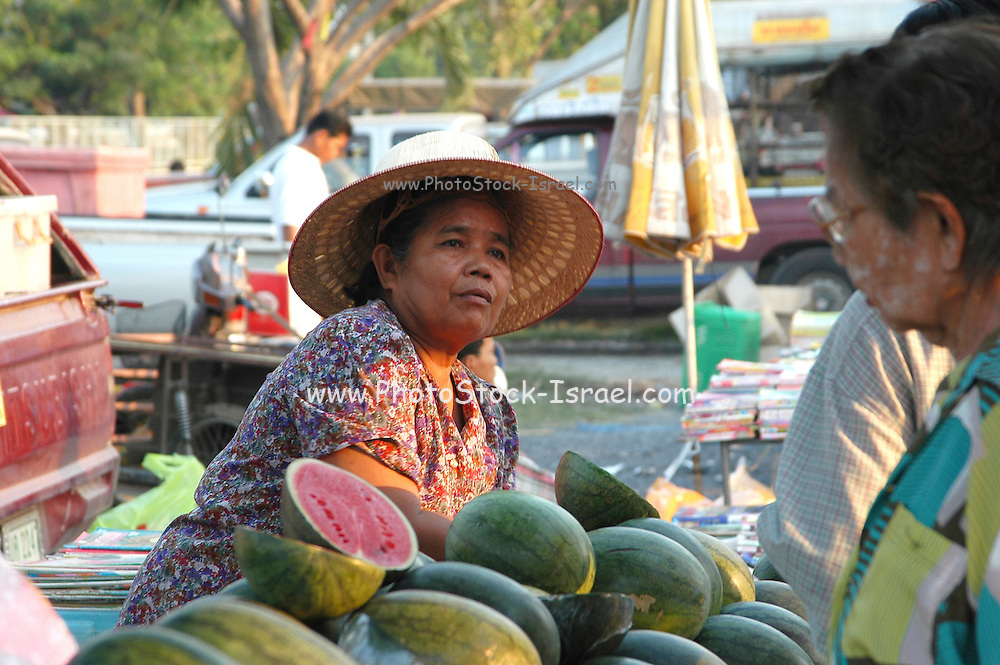 selling watermelons at the food Market at Lopburi, Thailand Lopburi is a city in Thailand, capital of the Lopburi province. The city is located about 150km north-east of Bangkok. Today the city is most famous because of its monkeys. Especially around the Khmer temple Prang Sam Yot hundreds of Crab-Eating Macaques (Macaca fascicularis) live in the middle of the city. Especially during the Monkey festival in November they are fed by the local people, but being used to humans they steal whatever food they can find.