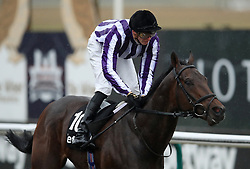 Victory Bond ridden by James Doyle wins the Betway Easter Classic All-Weather Middle Distance Championships Conditions Stakes during the AW Championship Finals Day at Lingfield Racecourse.