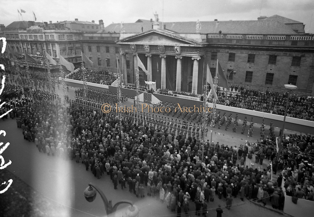 1916 Jubilee Commemorations- Parade and Ceremonies at the General Post Office. General view of the Military Parade at flag-decorated O'Connell Street. President Eamon de Valera (on reviewing stand) takes the salute as a Naval Detachment passes the G.P.O. On the reviewing stand also are the veterans of the 1916 Rising.<br /> 1966.<br /> 10.04.1966<br /> 04.10 1966.<br /> 10th April 1966.