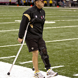 October 23, 2011; New Orleans, LA, USA; New Orleans Saints head coach Sean Payton heads off the field on crutches prior to kickoff of a game against the Indianapolis Colts at the Mercedes-Benz Superdome. Mandatory Credit: Derick E. Hingle-US PRESSWIRE / © Derick E. Hingle 2011