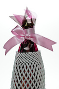 pink bow gift wrapped bottle with transport protection foam