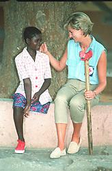 Diana, Princess of Wales, with Sandra Tigica 13, at the orthopaedic workshop in Neves Mendinha, near Launda, Angola.