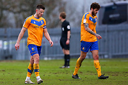 A dejected Ollie Clarke and Ryan Sweeney of Mansfield Town return to their half after Cambridge United make it 3-0 - Mandatory by-line: Ryan Crockett/JMP - 20/02/2021 - FOOTBALL - One Call Stadium - Mansfield, England - Mansfield Town v Cambridge United - Sky Bet League Two