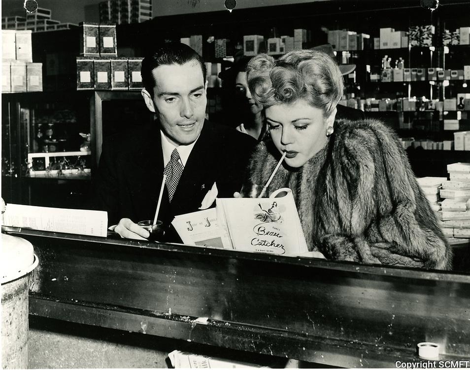 1945 Angela Lansbury and Hurd Hatfield at Schwab's Pharmacy