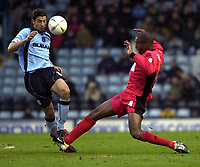 Photo: Greig Cowie<br />Nationwide League Division 1. Coventry v Wimbledon. 08/03/2003<br />Youssef Chipo and Nigel Reo-Coker clash