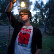 """Portrait of Alec Loorz, a teenage environmental activist. A light went on after he watched """"The Inconvenient Truth"""" and he started his career as environmental activist at age 12 while still in middle school. Loorz now travels the country as a speaker. Photographed for Teaching Tolerance."""