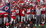 MORNING JOURNAL.DAVID RICHARD.Ohio State head coach Jim Tressel, front right, and the Buckeyes sing Carmen Ohio after yesterday's win over Cincinnati.