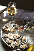 Happy hour oysters at The Walrus and the Carpenter in Ballard. In the background is a glass of Serge Batard Muscadet white wine.<br />