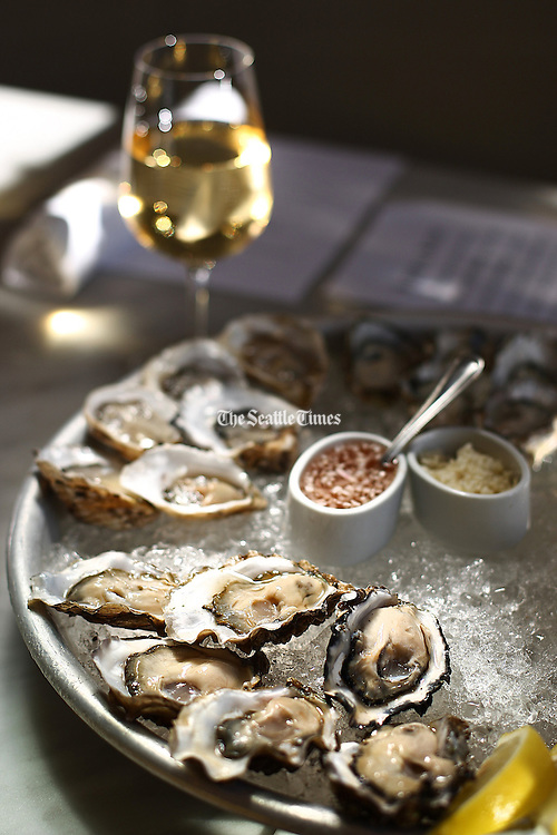 Happy hour oysters at The Walrus and the Carpenter in Ballard. In the background is a glass of Serge Batard Muscadet white wine.<br /> John Lok / The Seattle Times