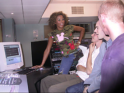 Mel B, Scary spice speaks to students working in the studio at the  Host Media Centre in Chapeltown Leeds on Thursday evening after she had performed the official opening