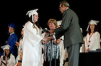 Elizabeth Jenkins receives her diploma and congratulations from Patricia Kennelly and Dr Phil McCormack during Inter Lakes High School Graduation at Meadowbrook Pavilion Friday evening.  (Karen Bobotas/for the Laconia Daily Sun)