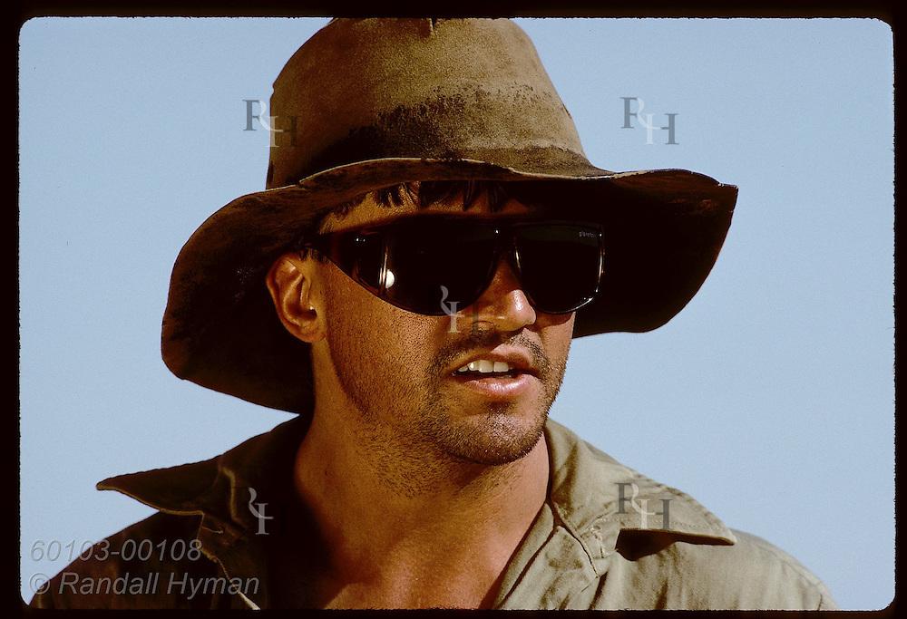 Geoff Lundie-Jenkins wears shades & hat when doing field work at mala reintro site; Tanami Desert Australia