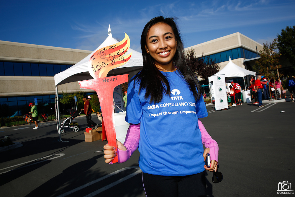 Angela Abarquez of Walnut Creek poses with a torch in remembrance of her grandma Josie during the 2014 Silicon Valley Heart & Stroke Walk at KLA-Tencor in Milpitas, California, on October 11, 2014. (Stan Olszewski/SOSKIphoto)