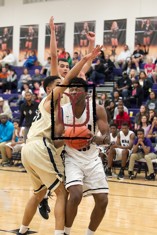 Cedar Ridge's Jerrod Smith attempts a basket against Akins at home Tuesday.  The Raiders beat the Eagles 60-58.  (LOURDES M SHOAF for Round Rock Leader.)