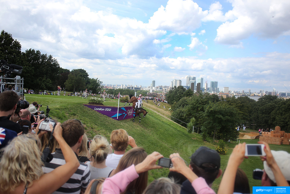Takayuki Yumira, Japan riding Latina navigates a difficult jump during the Cross Country event in the Eventing competition in front of massive crowds at Greenwich Park  during the London 2012 Olympic games. London. UK. 29th July 2012. Photo Tim Clayton